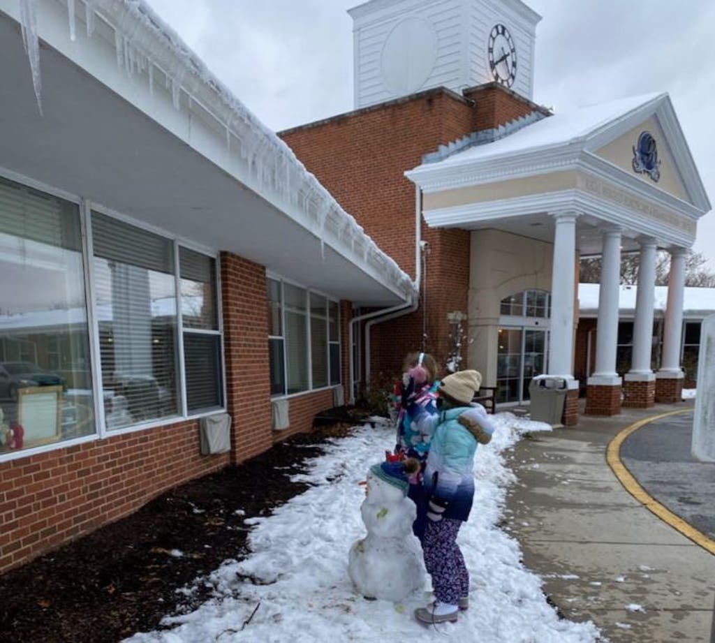 About a dozen kids answered a call to build snowmen at Regal Heights Nursing Home